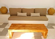 Wooden coffee table in front of a couch