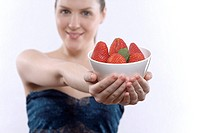 Close up of woman with bowl of strawberries