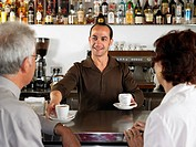 Businesspeople at a bar drinking coffee
