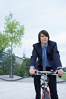 Businessman on bike laughing