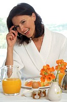 Woman ina bathrobe at the breakfast table