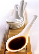 Asian spoon with soy sauce