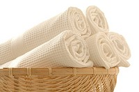 A basket full of white piqué-towels