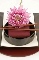 Asian place setting with a blossom