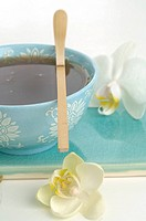 A cup of tea with a bamboo spoon