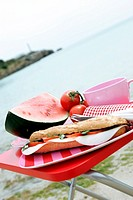 Tomato-mozzarella sandwich, watermelon and tomatos on the beach
