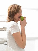 Woman is eating an apple