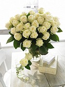 Bouquet of white roses and gifts