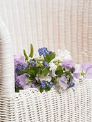 Bouquet of sweet pea and forget-me-not on a bench