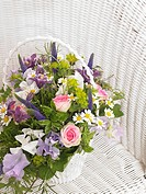 Roses, sweet pea, veronica, camomile and, akelei in a basket