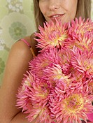 Woman with a bouquet of chrysanthemum