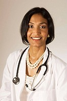 Ethnic woman in white lab coat with stethoscope