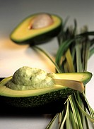 Avocado half with body mask Persea americana (thumbnail)