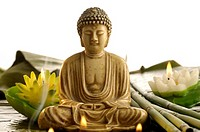Buddha with smoke and candles looking like water lilies