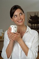 Young woman with a tea mug
