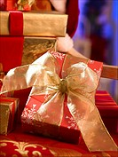 Red Christmas gift with a golden ribbon