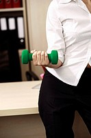 Office worker weight lifting