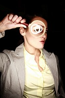 Woman with magnifying glass on eye