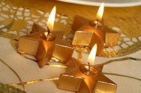 Golden Christmas star shape candles