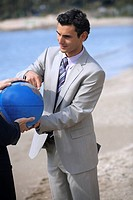 Businessmen hands grasping the globe