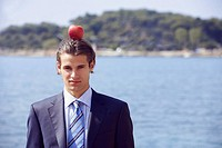 Businessman with apple balanced on his head