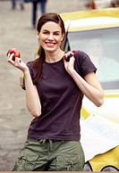 Woman posing with apple