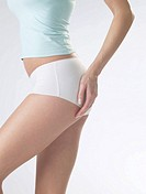 Woman wearing white underwear, cut of waist and femoral