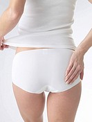 Woman wearing white underwear, cut of backside