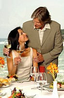 Couple at the sea with wine glasses