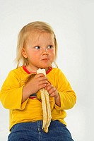 Close-up of a girl eating a banana