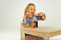 Portrait of a girl eating jam with a spoon