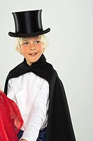 Boy dressed as a magician and smiling