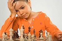 Close-up of a girl playing chess