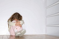 Young girl hugging herself and lonely