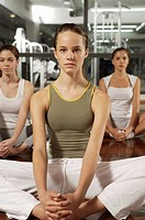 Three young women exercising in a gym