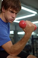 Close-up of a young man exercising with a dumbbell (thumbnail)
