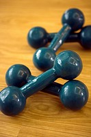 Close-up of two pairs of dumbbells