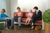 Patients sitting in a waiting room