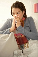 Mid adult woman suffering from cold