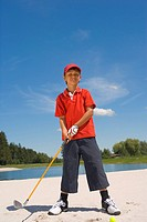 Portrait of a boy playing golf