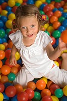 Portrait of a girl smiling in a ball pool