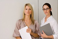 Portrait of two businesswomen standing in an office
