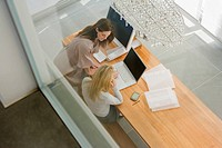 High angle view of two businesswomen working in an office