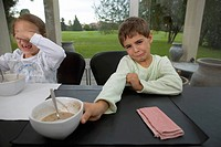Children at table refusing to eat