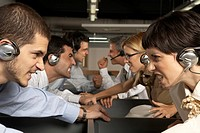 Group of customer service representatives looking at each other and clenching teeth