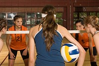 Five volleyball players playing volleyball