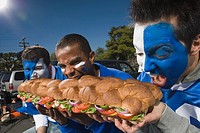 Hungry fans with sandwich