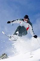 Snow skier in midair
