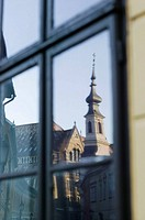 Small lutheran church at Castle Hill reflected in window. Budapest. Hungary