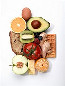 Bread, waffle and egg with fruits and vegetables, overhead view